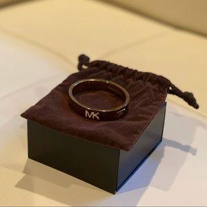 Michael Kors gold bracelet with rhinestone logo